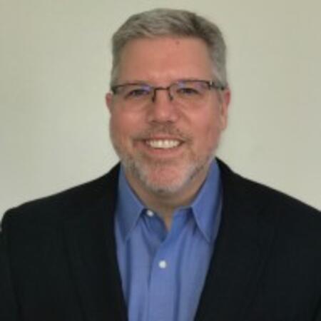 Chris Flynn, VP of IT Employee Enablement, Okta